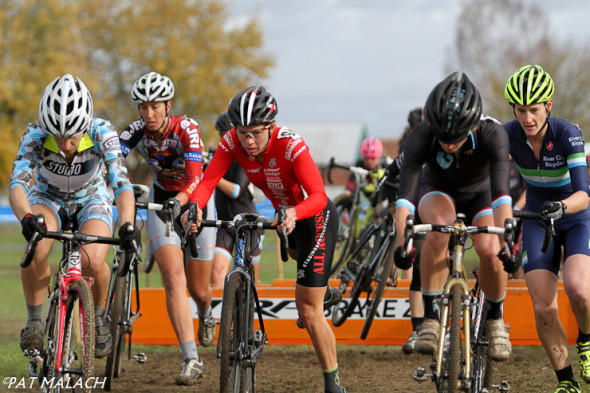 The Women's A field goes over the barriers early on the first lap. © Pat Malach