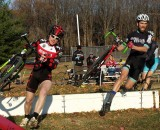 Patrick Blair, left, and Tim Rugg charging over the barriers. © Neil Schirmer