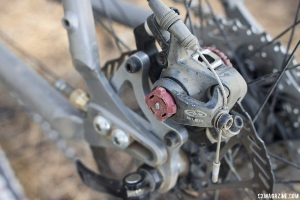 Jesse Reeves' Triton titanium gravel bike has sliding dropouts to go single or geared. A BB7 MTN disc caliper is compatible with his V-brake drop bar brake levers. © Cyclocross Magazine