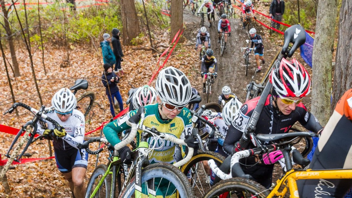 The Elite Women hit the pro-only section of the course, a challenging bit even without today's rain-slicked mud © Todd Prekaski