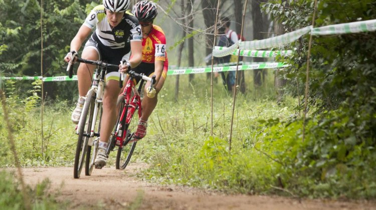 Hannah Payton dashing through the woods earlier this year at the QianSen Trophy in China. © Cyclocross Magazine