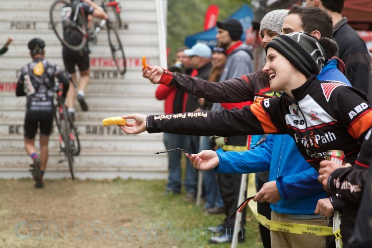 Hand-ups may not be a crime when it's hot, but this isn't what the UCI has in mind. photo: Twinkies, Twizzlers (both black and red), and Cheetos were some of the favorite hand-ups offered to a Cat 4/5 field. Photo by SnowyMountain Photography