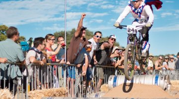 Evil Knielvel gets big air, entertains fans over the beer kegs. 2015 ClifBar Cykel Scramble. © A. Yee / Cyclocross Magazine