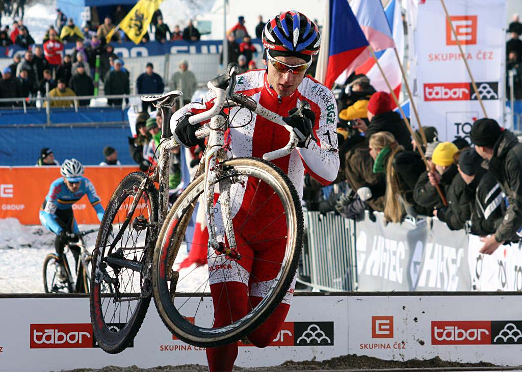 Poland\'s Pawel Szczepaniak ahead of Jim Aernouts early in the race. 2010 U23 Cyclocross World Championships. ? Bart Hazen