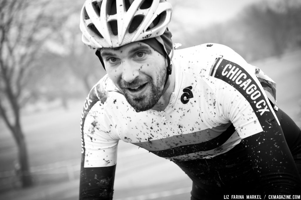 Jonathan Fairman (Chicago.CX) enjoying the mud-filled course in the 30-plus. ©Liz Farina Markel