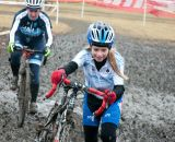 Tess Anderson (Spin Doctor Cyclewerks) charges through the mud. ©Liz Farina Markel