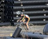 A rider pushes through a corridor of culverts on the course. ©Pat Malach