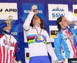 The women's podium celebrates with a drink of bubbly