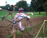 Helen Wyman running through the mud. © Cyclocross Magazine