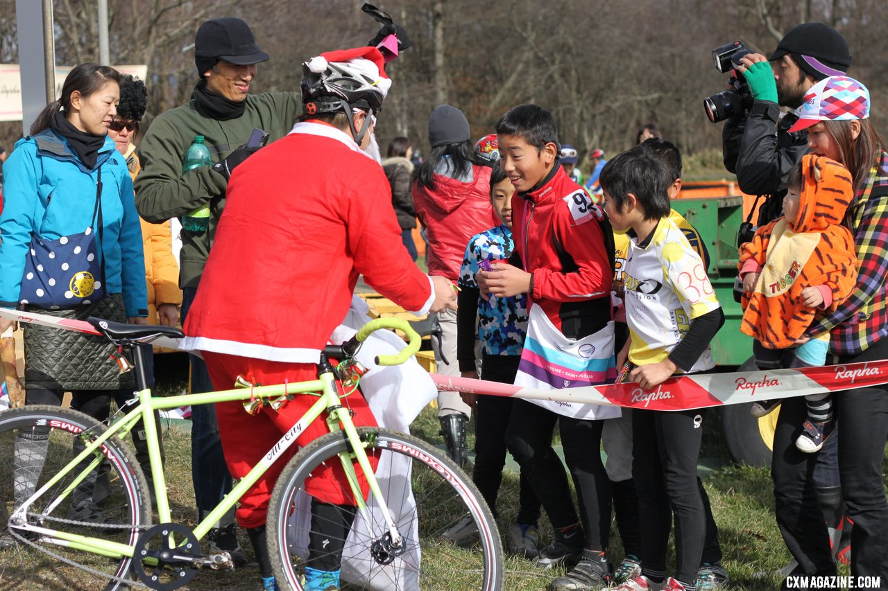 A Santa stopped along the course in the singlepseed race to give out candy to the kids. 2011 Nobeyama, Japan UCI Cyclocross Race. © Cyclocross Magazine