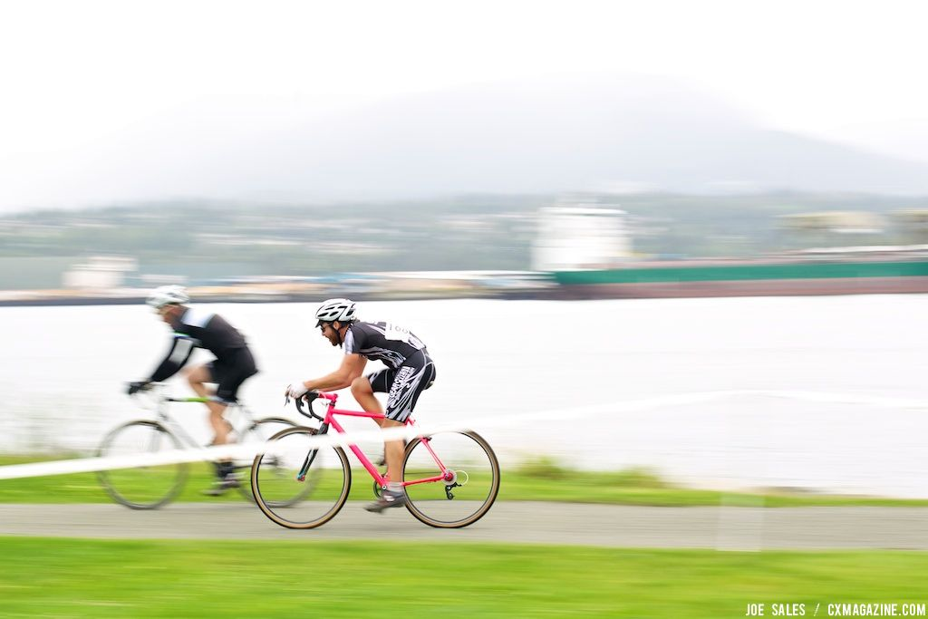 Two masters racers zoom along the waterfront pathway. © Joe Sales