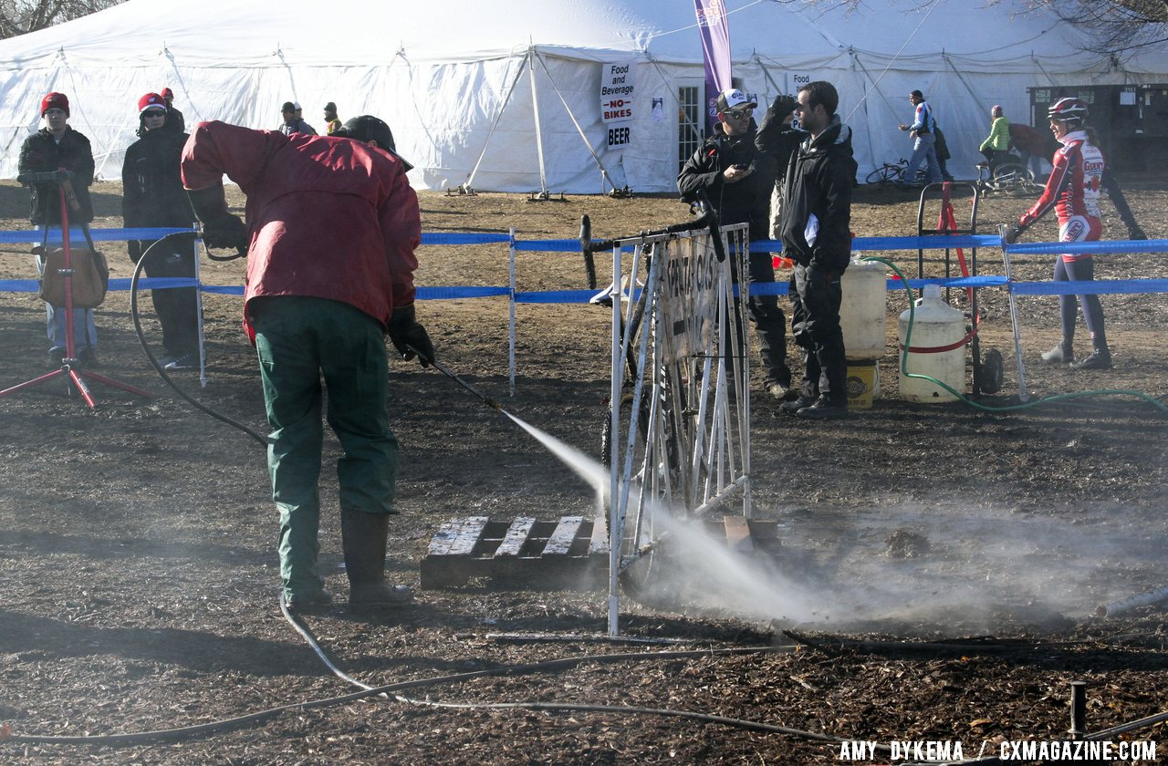 The pits were busy during the muddy Junior race. © Amy Dykema