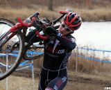 Emma White shoulders her bike up the run-up. © Cyclocross Magazine
