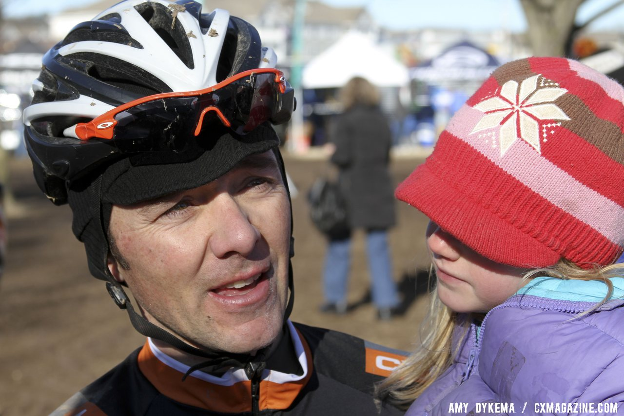 Brandon Dwight celebrates with a little one. 2012 Cyclocross National Championships, Masters Men 40-44. ©Amy Dykema