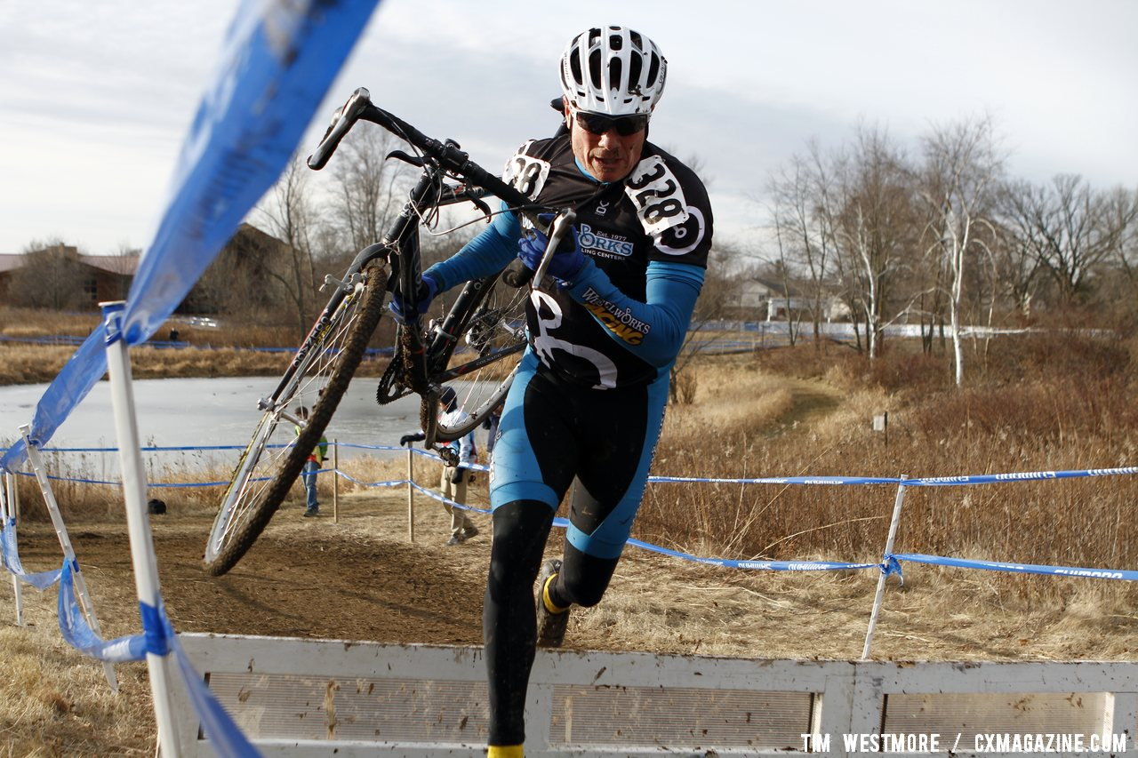 The Downhill-Off Camber-Barriers Created A Lot of Different Bike Carry Methods © Cyclocross Magazine