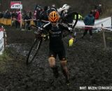 Jeremy Durrin (Optum p/b Kelly Benefit Strategies) runs through the mud. © Bart Hazen / Cyclocross Magazine