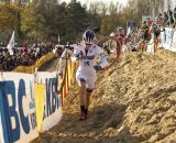 Katie Compton (Trek Cyclocross Collective) takes the low line to move up in position. © Thomas van Bracht
