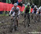Lars van der Haar leads a group through the off-camber mud. © Bart Hazen / Cyclocross Magazine