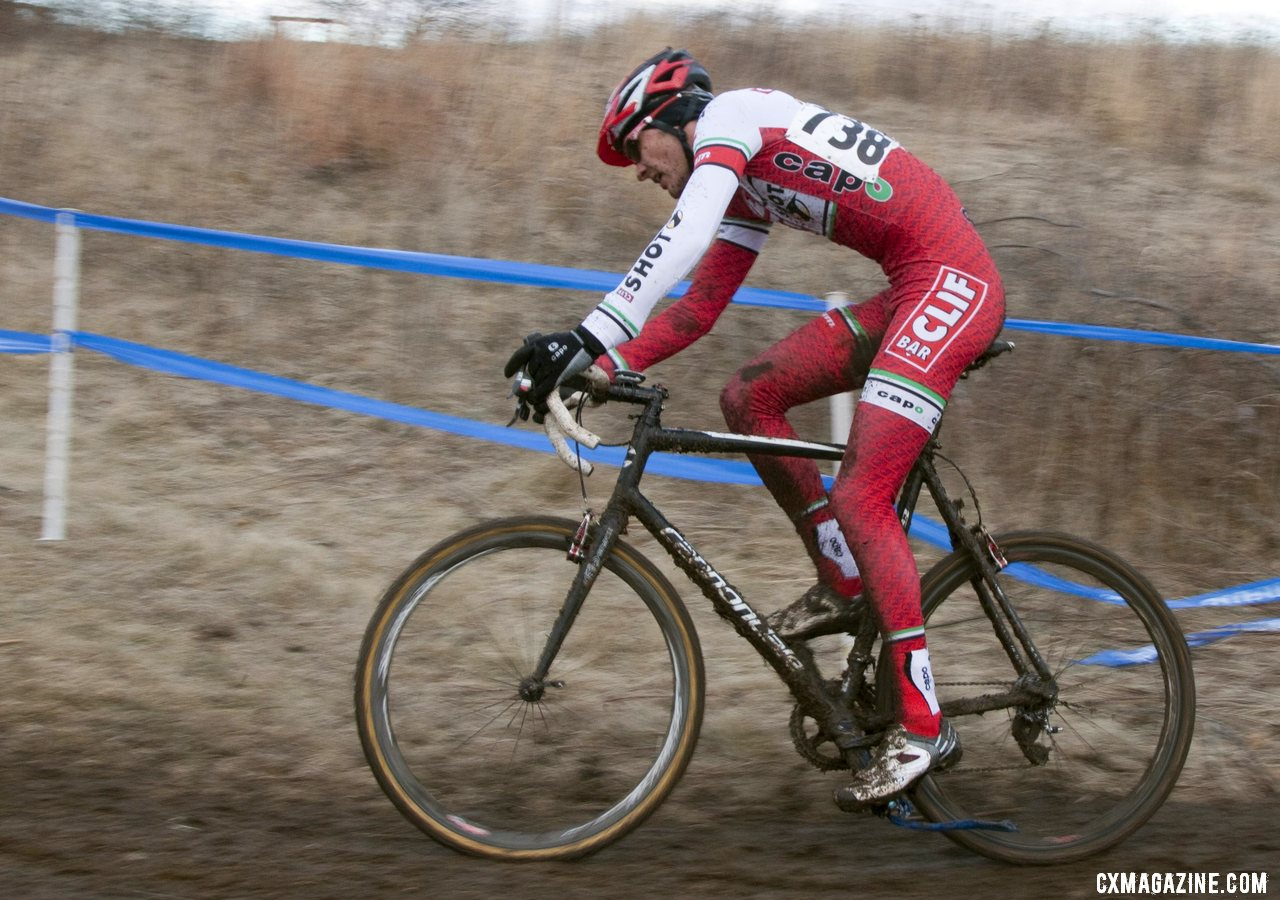 Brady Kapius rides with course tape caught in his crankset. © Cyclocross Magazine