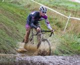 Peter Goguen hits the mud with a splash. © Todd Prekaski
