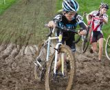 Ana Sirianni determinedly charges through the mud. © Todd Prekaski