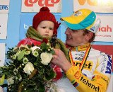 Bart Wellens holding his child on the podium as he finished 2nd the 2011 Belgian Championship cyclo cross race in Antwerpen. Sunday Jan. 9, 2010. ( SPRIMONT PRESS / Laurent Dubrule )