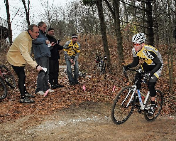 Cowbells ring as Rochester Bike Shop rider Adam Naish races through the woods ? Andrea Tucker 2009