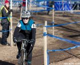 Julie O'Neil on her way to the top step.  ©Brian Nelson