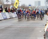 The women charge at the start with Lucie Chainel-Lefevre taking the holeshot at the Elite World Championships of Cyclocross 2013. © Brian Nelson