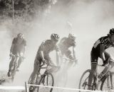 In a dust cloud, the riders came together in a pack. © Joe Sales