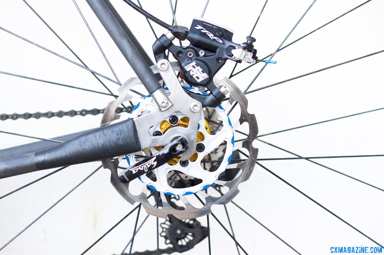Titanium dropouts are made by Calfee and keep the weight low on the NAHBS Calfee Manta CX Prototype. Scrub MMC rotor, TRP HyRd hydraulic disc brake. © Cyclocross Magazine