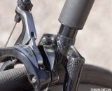 Small elastomer balls inside the wishbone offer up to 1cm of travel on Calfee's new Manta softtail suspension platform. © Cyclocross Magazine
