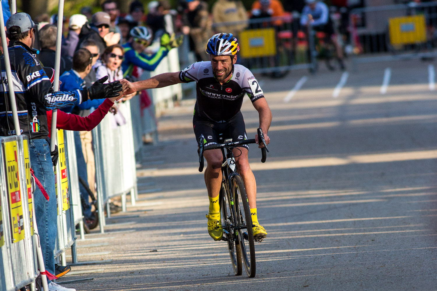 Tim Johnson high-five's fans on the way to the win. © Kent Baumgardt
