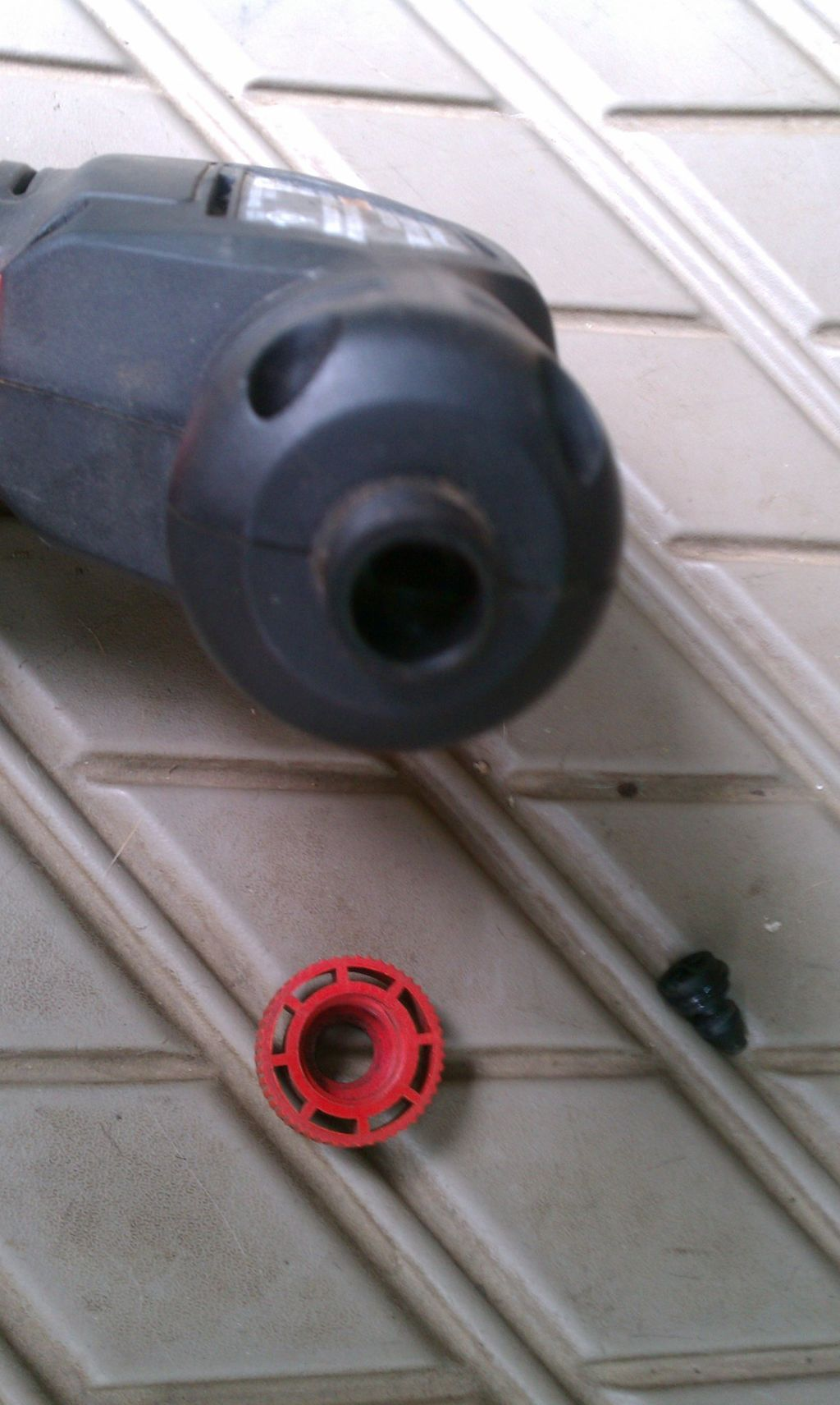 step-three-remove-the-red-knob-from-the-inflator-and-remove-the-chuck-that-is-in-there