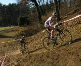 Elliott and Van Gilder chase on the climb that had many women carrying their bikes.? Paul Weiss