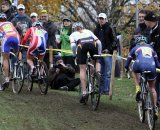 The women's field charges up a hill on the championship course. © Bart Hazen