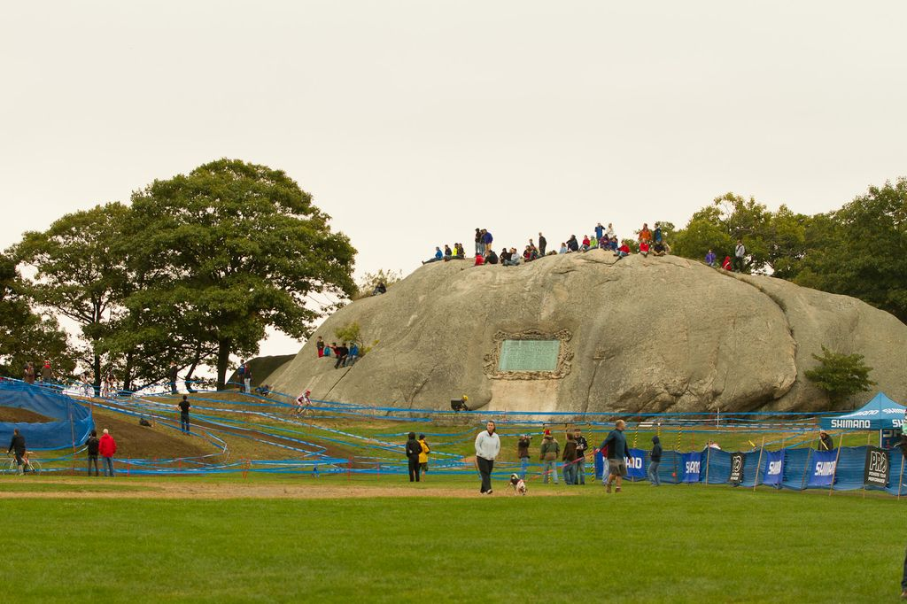 The best seat in the house: spectators watch from atop a boulder at Stage Fort Park © Todd Prekaski
