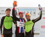 Elite men's podium: Johnson third, Trebon second, Powers wins, but should keep an eye on his beer.   © Todd Prekaski