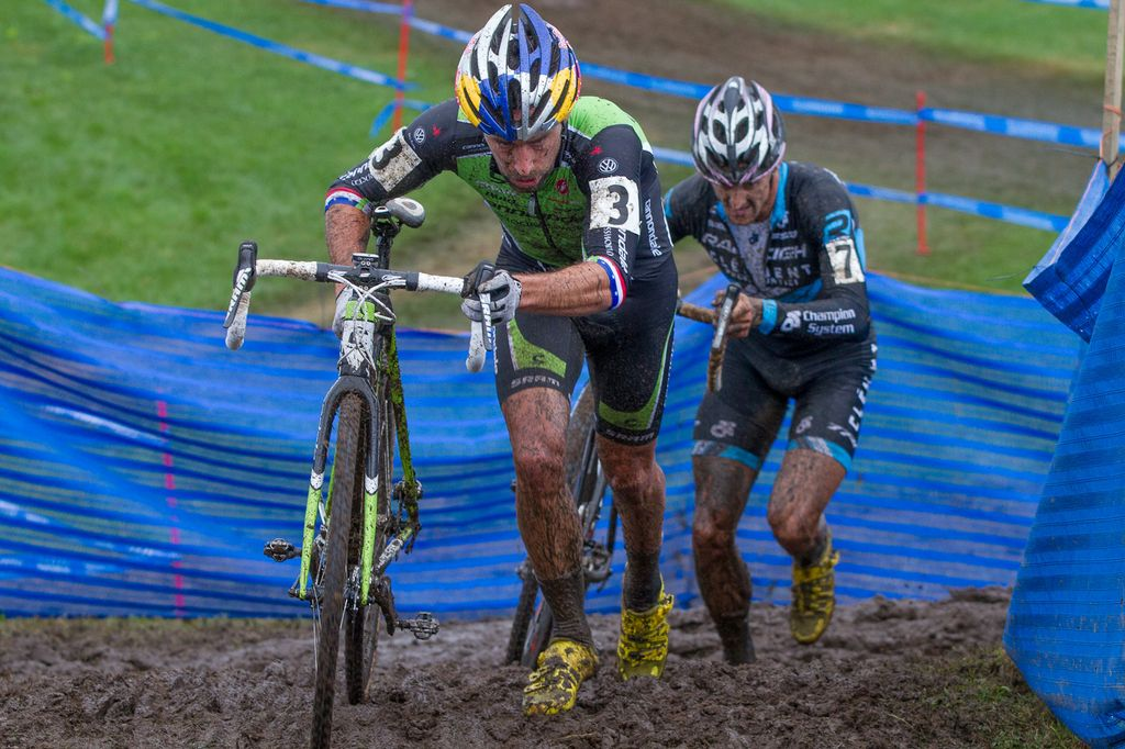 Johnson and Berden on an unridable section of the muddy off-camber turns © Todd Prekaski