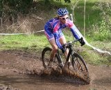 Karen Brems rushes the mud pit. © Paul Guerra