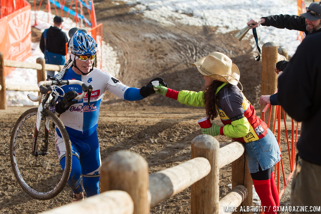 Taking handups in the men\'s 50-54 race at 2014 USA Cyclocross National Championships. © Mike Albright