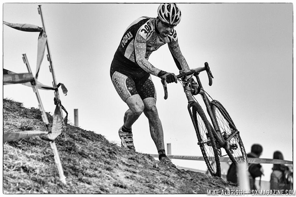 Taking the off-camber in the men\'s 50-54 race at 2014 USA Cyclocross National Championships. © Mike Albright