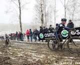 Gunnar Bergy and Cypress Gorry work their way up a muddy climb © Tom Robertson