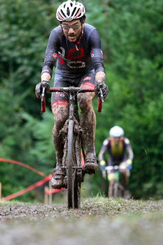 Cyclocross Magazine\'s Josh Liberles riding in a muddy fog © Matt Haughey