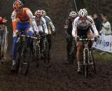 The lead group fights to keep momentum in the mud. ? Bart Hazen
