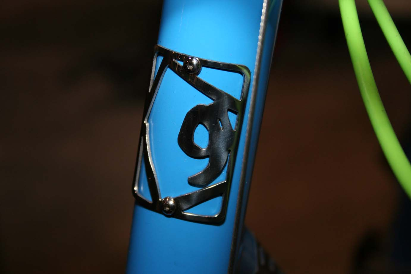 An intricate, metal head badge indicates this isn't a mass-produced frame.  ?Cyclocross Magazine