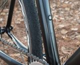 Bottle cage mounts are covered with electrical tape rather than bolts which could snag when shouldering.