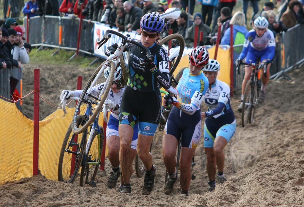 CXM\'s Christine Vardaros leads a group through the sand. ?Bart Hazen