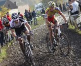 Wietse Bosmans and Vinnie Braet slip along in the mud © Bart Hazen
