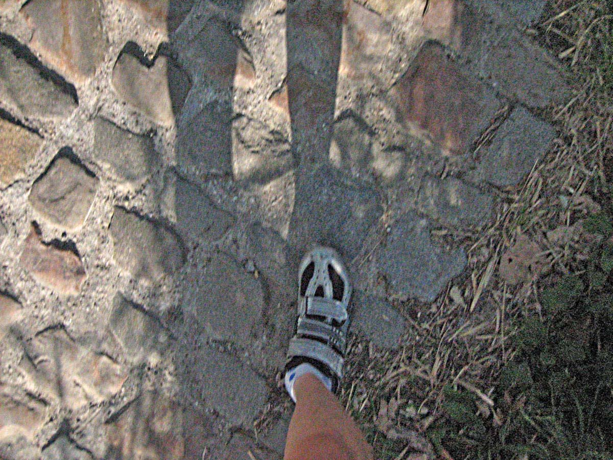 My foot on the koppenberg cobbles.  by Christine Vardaros